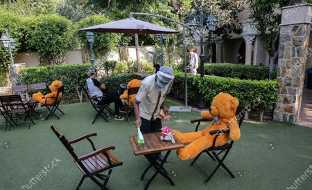 Teddy bears are placed to encourage social distancing at Rustique cafe in New Delhi, India, 25 September 2020. People around the world are trying to find unique ways to ensure social distancing at public places. India has the second highest total of confirmed COVID-19 cases in the world.