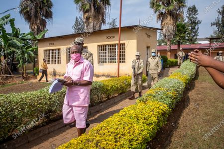 """Stock Picture of Paul Rusesabagina, whose story inspired the film """"Hotel Rwanda"""", wears a pink prison uniform as he arrives for a bail hearing at a court in the capital Kigali, Rwanda . Rusesabagina admitted in court that he helped to form the National Liberation Front rebel group in order to assist Rwandan refugees, but denied that he supported any violence or killings"""