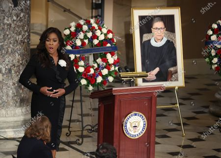 Stock Photo of Denyce Graves sings as U.S. Supreme Court Associate Justice Ruth Bader Ginsburg's flag-draped casket rests on the Lincoln catafalque in Statuary Hall as she lies in state at the U.S. Capitol on September 25, 2020 in Washington, DC. Ginsburg, who was appointed by former U.S. President Bill Clinton, served on the high court from 1993 until her death on September 18, 2020. She is the first woman to lie in state at the Capitol.