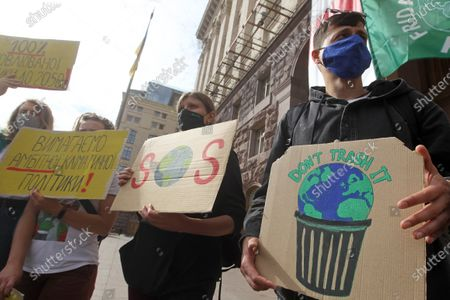 Protesters hold placards expressing their opinion during the demonstration outside City Hall in Kiev. Climate activists all over the globe united for the first global climate strike action of 2020 held worldwide amid the COVID-19 coronavirus pandemic. The Global Day of Climate Action is a part of student protest, the Fridays for Future movement aiming to spark the world leaders into action on climate change.