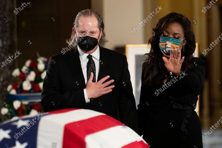 Opera singer Denyce Graves, right, pays her respects to the late Justice Ruth Bader Ginsburg as she lies in state in Statuary Hall of the Capitol in Washington, DC on September 25, 2020.