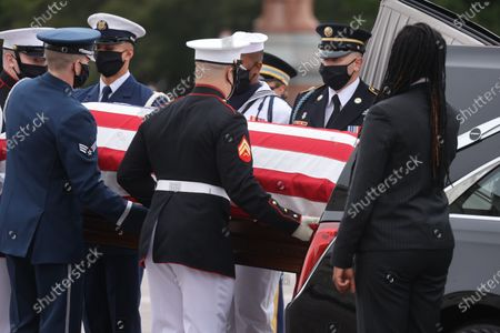 The casket of the late Supreme Court Associate Justice Ruth Bader Ginsburg is carried by a military honor guard as it arrives at the U.S. Capitol, where it will lie in state in Statuary Hall in Washington, U.S., September 25, 2020.