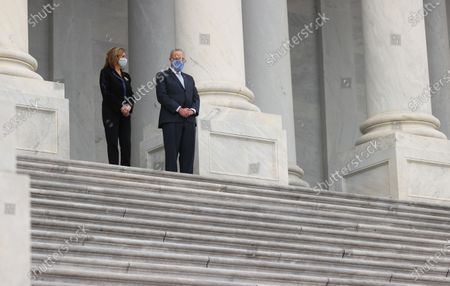 Speaker of the United States House of Representatives Nancy Pelosi (Democrat of California) and United States Senate Minority Leader Chuck Schumer (Democrat of New York) talk as they await the arrival of the casket of the late Supreme Court Associate Justice Ruth Bader Ginsburg while standing at the top of the steps of the U.S. Capitol in Washington, U.S., September 25, 2020.