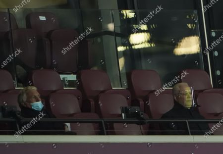 Sir Trevor Brooking and David Gold sitting in the stands in face masks