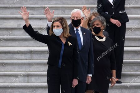 Speaker of the House Nancy Pelosi (Front) and House Majority Leader Steny Hoyer (C) join other lawmakers, most of which are Democratic women, in waving goodbye as the hearse departs the East Front of the US Capitol after the late US Supreme Court Justice Ruth Bader Ginsburg lay in state in National Statuary Hall, in Washington, DC, USA, 25 September 2020. Ginsburg is the first woman and Jewish person to lie in state at the US Capitol.