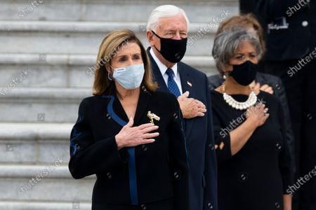 Speaker of the House Nancy Pelosi (Front) and House Majority Leader Steny Hoyer (C) join other lawmakers, most of which are Democratic women, in watching an honor guard carry the flag-draped casket of late US Supreme Court Justice Ruth Bader Ginsburg at the East Front of the US Capitol after Ginsburg lay in state in National Statuary Hall, in Washington, DC, USA, 25 September 2020. Ginsburg is the first woman and Jewish person to lie in state at the US Capitol.