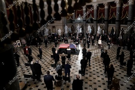 Stock Image of The late Justice Ruth Bader Ginsburg lies in state at National Statuary Hall in the U.S. Capitol during a ceremony on Friday, September 25, 2020. Ginsburg died at the age of 87 on Sept. 18th and is the first women to lie in state at the Capitol.