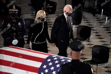 Dr. Jill Biden and Democratic presidential candidate former US Vice President Joe Biden pay their respects as the late Justice Ruth Bader Ginsburg lies in state at National Statuary Hall in the U.S. Capitol on Friday, September 25, 2020. Ginsburg died at the age of 87 on Sept. 18th and is the first women to lie in state at the Capitol.