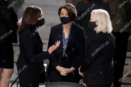 Democratic vice presidential candidate United States Senator Kamala Harris (Democrat of California) speaks to US Senator Amy Klobuchar (Democrat of Minnesota) and US Senator Kirsten Gillibrand (Democrat of New York) prior to a ceremony to honor the late Justice Ruth Bader Ginsburg as she lies in state at National Statuary Hall in the U.S. Capitol on Friday, September 25, 2020. Ginsburg died at the age of 87 on Sept. 18th and is the first women to lie in state at the Capitol.