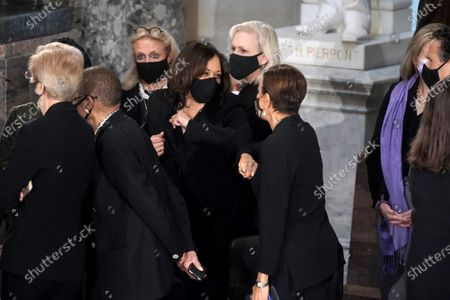 Democratic vice presidential candidate United States Senator Kamala Harris (Democrat of California) elbow bumps US Representative Nydia Velazquez (Democrat of New York) prior to a ceremony to honor the late Justice Ruth Bader Ginsburg as she lies in state at National Statuary Hall in the U.S. Capitol on Friday, September 25, 2020. Ginsburg died at the age of 87 on Sept. 18th and is the first women to lie in state at the Capitol.