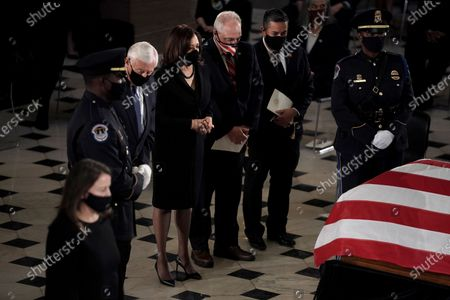 United States House Majority Leader Steny Hoyer (Democrat of Maryland), Democratic vice presidential candidate US Senator Kamala Harris (Democrat of California), US House Minority Whip Steve Scalise (Republican of Louisiana) and US Representative Ben Ray Lujan (Democrat of New Mexico) pay their respects as the late Justice Ruth Bader Ginsburg lies in state at National Statuary Hall in the U.S. Capitol on Friday, September 25, 2020. Ginsburg died at the age of 87 on Sept. 18th and is the first women to lie in state at the Capitol.