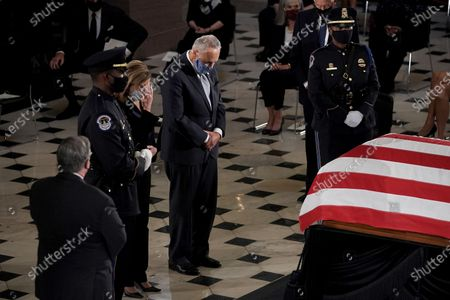Speaker of the United States House of Representatives Nancy Pelosi (Democrat of California) and United States Senate Minority Leader Chuck Schumer (Democrat of New York) pay their respects as the late Justice Ruth Bader Ginsburg lies in state at National Statuary Hall in the U.S. Capitol on Friday, September 25, 2020. Ginsburg died at the age of 87 on Sept. 18th and is the first women to lie in state at the Capitol.