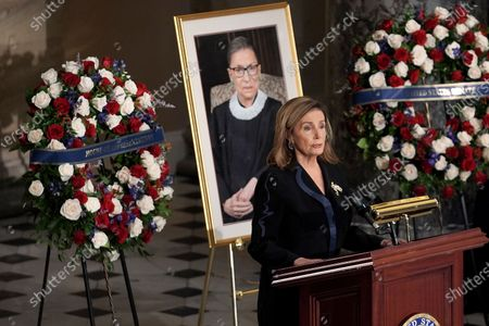 Stock Photo of Speaker Nancy Pelosi (D-Calif.) speaks during a ceremony to honor the late Justice Ruth Bader Ginsburg as she lies in state at National Statuary Hall in the U.S. Capitol on Friday, September 25, 2020. Ginsburg died at the age of 87 on Sept. 18th and is the first women to lie in state at the Capitol.