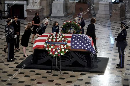 Lizzie Fletcher (D-Texas), Katherine Clark (D-Mass.), and Lisa Blunt Rochester (D-Del.) pay their respects as the late Justice Ruth Bader Ginsburg lies in state at National Statuary Hall in the U.S. Capitol in Washington, DC, USA, 25 September 2020. United States Supreme Court Justice Ruth Bader Ginsburg died on 18 September 2020 at the age of 87. Justice Ginsburg, also known as RBG, took office on 10 August 1993 after an appointment by then US President Bill Clinton. She was the oldest of the nine serving supreme court judges at the time of her death.