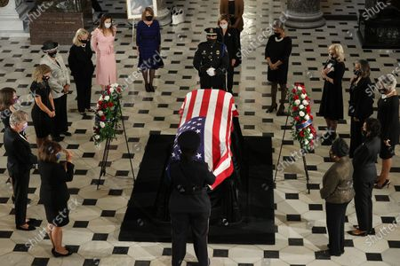 Members of the House of Representatives, including Speaker of the House Nancy Pelosi (D-CA), encircle U.S. Supreme Court Associate Justice Ruth Bader Ginsburg's flag-draped casket to pay their respects as she lies in state in Statuary Hall at the U.S. Capitol in Washington, DC, USA, 25 September 2020. United States Supreme Court Justice Ruth Bader Ginsburg died on 18 September 2020 at the age of 87. Justice Ginsburg, also known as RBG, took office on 10 August 1993 after an appointment by then US President Bill Clinton. She was the oldest of the nine serving supreme court judges at the time of her death.
