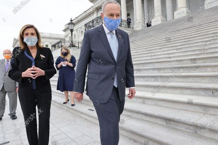 U.S. House Speaker Nancy Pelosi (D-CA) and Senate Minority Leader Chuck Schumer (D-NY) walk together following ceremonies honoring late U.S. Supreme Court Justice Ruth Bader Ginsburg at the U.S. Capitol in Washington, DC, USA, 25 September 2020. United States Supreme Court Justice Ruth Bader Ginsburg died on 18 September 2020 at the age of 87. Justice Ginsburg, also known as RBG, took office on 10 August 1993 after an appointment by then US President Bill Clinton. She was the oldest of the nine serving supreme court judges at the time of her death.