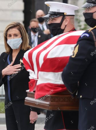 Speaker of the House Nancy Pelosi (D-CA) looks on as the casket of the late Supreme Court Associate Justice Ruth Bader Ginsburg is carried following ceremonies honoring Ginsburg at the U.S. Capitol in Washington, DC, USA, 25 September 2020. United States Supreme Court Justice Ruth Bader Ginsburg died on 18 September 2020 at the age of 87. Justice Ginsburg, also known as RBG, took office on 10 August 1993 after an appointment by then US President Bill Clinton. She was the oldest of the nine serving supreme court judges at the time of her death.