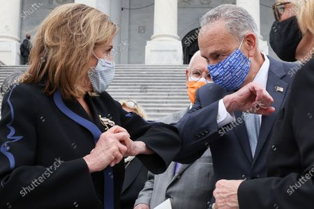 U.S. House Speaker Nancy Pelosi (D-CA) and Senate Minority Leader Chuck Schumer (D-NY) share an elbow greeting following ceremonies honoring late U.S. Supreme Court Justice Ruth Bader Ginsburg at the U.S. Capitol in Washington, DC, USA, 25 September 2020. United States Supreme Court Justice Ruth Bader Ginsburg died on 18 September 2020 at the age of 87. Justice Ginsburg, also known as RBG, took office on 10 August 1993 after an appointment by then US President Bill Clinton. She was the oldest of the nine serving supreme court judges at the time of her death.