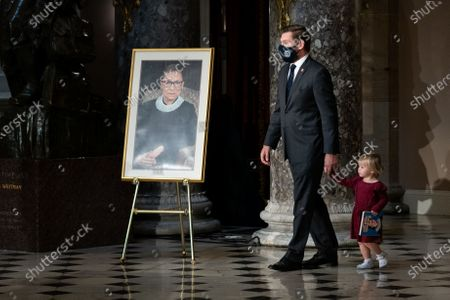 Rep. Eric Swalwell (D-CA) and his daughter Kathryn pay their respects as the late Justice Ruth Bader Ginsburg lies in state in Statuary Hall in the Capitol in Washington, DC, USA, 25 September 2020. United States Supreme Court Justice Ruth Bader Ginsburg died on 18 September 2020 at the age of 87. Justice Ginsburg, also known as RBG, took office on 10 August 1993 after an appointment by then US President Bill Clinton. She was the oldest of the nine serving supreme court judges at the time of her death.
