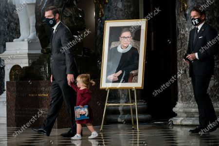 Stock Image of Rep. Eric Swalwell (D-CA) and his daughter Kathryn pay their respects as the late Justice Ruth Bader Ginsburg lies in state in Statuary Hall in the Capitol in Washington, DC, USA, 25 September 2020. United States Supreme Court Justice Ruth Bader Ginsburg died on 18 September 2020 at the age of 87. Justice Ginsburg, also known as RBG, took office on 10 August 1993 after an appointment by then US President Bill Clinton. She was the oldest of the nine serving supreme court judges at the time of her death.