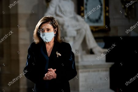 House Speaker Nancy Pelosi (D-CA) walks through Statuary Hall as people pay their respects to the late Justice Ruth Bader Ginsburg as she lies in state in Statuary Hall of the Capitol in Washington, DC, USA, 25 September 2020. United States Supreme Court Justice Ruth Bader Ginsburg died on 18 September 2020 at the age of 87. Justice Ginsburg, also known as RBG, took office on 10 August 1993 after an appointment by then US President Bill Clinton. She was the oldest of the nine serving supreme court judges at the time of her death.