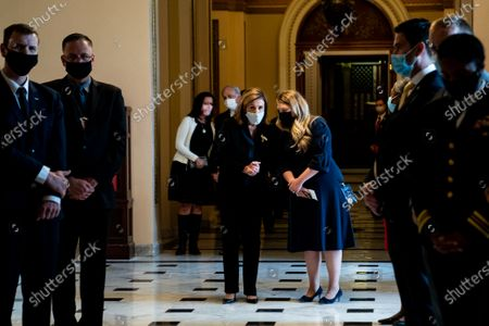House Speaker Nancy Pelosi (D-CA) and an aide confer in a hallway as people pay their respects to the late Justice Ruth Bader Ginsburg as she lies in state in Statuary Hall of the Capitol in Washington, DC, USA, 25 September 2020. United States Supreme Court Justice Ruth Bader Ginsburg died on 18 September 2020 at the age of 87. Justice Ginsburg, also known as RBG, took office on 10 August 1993 after an appointment by then US President Bill Clinton. She was the oldest of the nine serving supreme court judges at the time of her death.