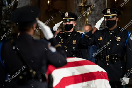 Honor guards salute before a change of the guard as the late Justice Ruth Bader Ginsburg lies in state in Statuary Hall in the Capitol in Washington, DC, USA, 25 September 2020. United States Supreme Court Justice Ruth Bader Ginsburg died on 18 September 2020 at the age of 87. Justice Ginsburg, also known as RBG, took office on 10 August 1993 after an appointment by then US President Bill Clinton. She was the oldest of the nine serving supreme court judges at the time of her death.