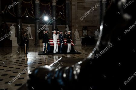 An honor guard prepares to carry the flag-draped casket of late US Supreme Court Justice Ruth Bader Ginsburg as she lies in state in Statuary Hall in the Capitol in Washington, DC, USA, 25 September 2020. United States Supreme Court Justice Ruth Bader Ginsburg died on 18 September 2020 at the age of 87. Justice Ginsburg, also known as RBG, took office on 10 August 1993 after an appointment by then US President Bill Clinton. She was the oldest of the nine serving supreme court judges at the time of her death.