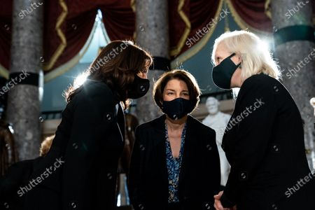 (L-R) Democratic Vice Presidential Candidate Kamala Harris talks with Senator Amy Klobuchar (D-MN) and Senator Kirsten Gillibrand (D-NY) before the start of a ceremony for the late Justice Ruth Bader Ginsburg who is lying in state in Statuary Hall in the Capitol in Washington, DC, USA, 25 September 2020. United States Supreme Court Justice Ruth Bader Ginsburg died on 18 September 2020 at the age of 87. Justice Ginsburg, also known as RBG, took office on 10 August 1993 after an appointment by then US President Bill Clinton. She was the oldest of the nine serving supreme court judges at the time of her death.