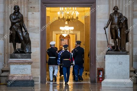 The casket of US Supreme Court Justice Ruth Bader Ginsburg is carried by an armed services body bearer team into Statuary Hall in the US Capitol in Washington, DC, USA, 25 September 2020. Justice Ginsburg, the second woman to serve on the Supreme Court, is the first woman to lie in state at the US Capitol. United States Supreme Court Justice Ruth Bader Ginsburg died on 18 September 2020 at the age of 87. Justice Ginsburg, also known as RBG, took office on 10 August 1993 after an appointment by then US President Bill Clinton. She was the oldest of the nine serving supreme court judges at the time of her death.