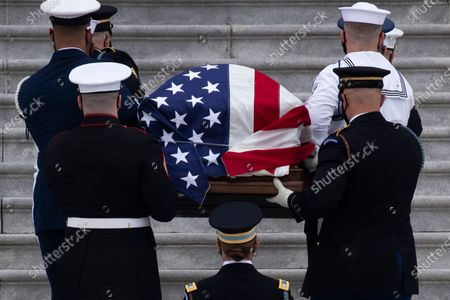 An honor guard carries the flag-draped casket of late US Supreme Court Justice Ruth Bader Ginsburg at the East Front steps of the US Capitol to lie in state in National Statuary Hall, in Washington, DC, USA, 25 September 2020. Ginsburg is the first woman and Jewish person to lie in state at the US Capitol. United States Supreme Court Justice Ruth Bader Ginsburg died on 18 September 2020 at the age of 87. Justice Ginsburg, also known as RBG, took office on 10 August 1993 after an appointment by then US President Bill Clinton. She was the oldest of the nine serving supreme court judges at the time of her death.
