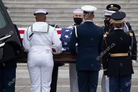 Stock Image of An honor guard takes the flag-draped casket of late US Supreme Court Justice Ruth Bader Ginsburg out of a hearse to carry up the East Front steps of the US Capitol to lie in state in National Statuary Hall, in Washington, DC, USA, 25 September 2020. Ginsburg is the first woman and Jewish person to lie in state at the US Capitol. United States Supreme Court Justice Ruth Bader Ginsburg died on 18 September 2020 at the age of 87. Justice Ginsburg, also known as RBG, took office on 10 August 1993 after an appointment by then US President Bill Clinton. She was the oldest of the nine serving supreme court judges at the time of her death.