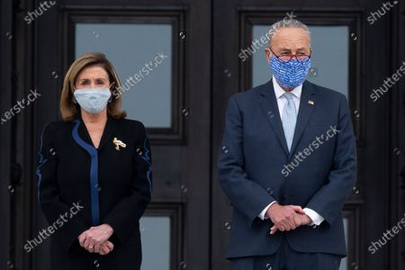 US Speaker of the House Nancy Pelosi (L) and Senate Minority Leader Democrat Chuck Schumer (R) wait at the East Front steps of the US Capitol for the arrival of the casket of late US Supreme Court Justice Ruth Bader Ginsburg to lie in state in National Statuary Hall in Washington, DC, USA, 25 September 2020. Ginsburg is the first woman and Jewish person to lie in state at the US Capitol. United States Supreme Court Justice Ruth Bader Ginsburg died on 18 September 2020 at the age of 87. Justice Ginsburg, also known as RBG, took office on 10 August 1993 after an appointment by then US President Bill Clinton. She was the oldest of the nine serving supreme court judges at the time of her death.