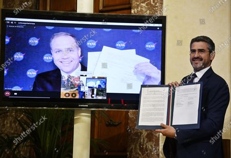 Riccardo Fraccaro (R), Undersecretary of State, and on screen Jim Bridenstine (L), NASA Administrator, during the sign of a space cooperation agreement with the United States at Palazzo Chigi, Rome, Italy, 25 February 2020.