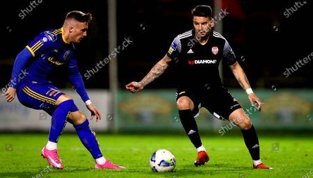 Bohemians vs Derry City. Bohemians' Daniel Grant with Adam Hammill of Derry City