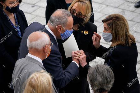 Speaker of the United States House of Representatives Nancy Pelosi (Democrat of California), right, talks with United States Senate Minority Leader Chuck Schumer (Democrat of New York) after Justice Ruth Bader Ginsburg lied in state at the U.S. Capitol, in Washington.
