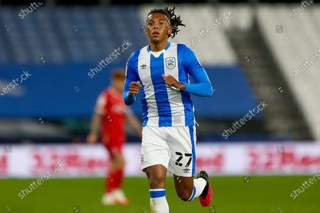 Stock Photo of Huddersfield Town Defender Romoney Crichlow-Noble (27) on the attack during the EFL Sky Bet Championship match between Huddersfield Town and Nottingham Forest at the John Smiths Stadium, Huddersfield