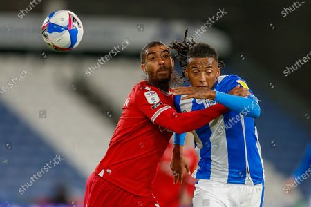 Nottingham Forest FC Forward Lewis Grabban (7) competes for the ball with Huddersfield Town Defender Romoney Crichlow-Noble (27) during the EFL Sky Bet Championship match between Huddersfield Town and Nottingham Forest at the John Smiths Stadium, Huddersfield