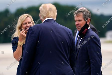 Stock Picture of President Donald Trump greets Georgia Gov. Brian Kemp and his wife Marty as he arrives at Dobbins Air Reserve Base for a campaign event at the Cobb Galleria Centre, in Atlanta