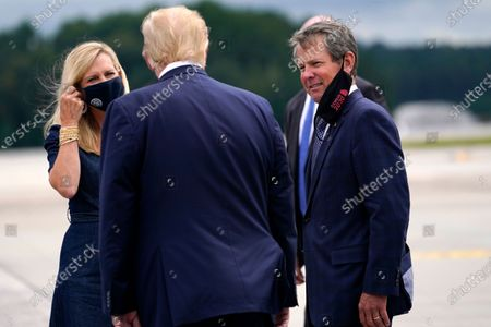 President Donald Trump greets Georgia Gov. Brian Kemp and his wife Marty as he arrives at Dobbins Air Reserve Base for a campaign event at the Cobb Galleria Centre, in Atlanta