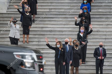 Stock Photo of Speaker of the United States House of Representatives Nancy Pelosi (Democrat of California), center, joins other members of Congress as they wave good bye while the casket carrying Supreme Court Justice Ruth Bader Ginsburg departs the US Capitol in Washington, DC., Friday, September 25, 2020, after lying in state in Statuary Hall. Justice Ginsburg died from her battle with pancreatic cancer and is the first woman to lie in state at the US Capitol.