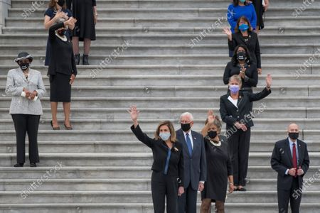 Speaker of the United States House of Representatives Nancy Pelosi (Democrat of California), center, joins other members of Congress as they wave good bye while the casket carrying Supreme Court Justice Ruth Bader Ginsburg departs the US Capitol in Washington, DC., Friday, September 25, 2020, after lying in state in Statuary Hall. Justice Ginsburg died from her battle with pancreatic cancer and is the first woman to lie in state at the US Capitol.