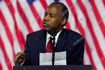 Secretary of Housing and Urban Development Ben Carson holds notes as he speaks during a campaign event before President Donald Trump at the Cobb Galleria Centre, in Atlanta
