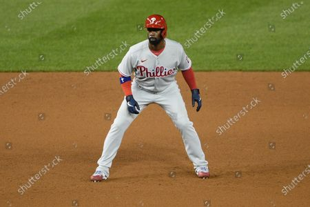 Philadelphia Phillies' Andrew McCutchen stands on the field during the second baseball game of a doubleheader, in Washington. This game is a makeup from Aug. 27. The Nationals won 8-7 in extra innings