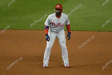 Philadelphia Phillies' Andrew McCutchen stands on the field during the second baseball game of a doubleheader against the Washington Nationals, in Washington. This game is a makeup from Aug. 27. The Nationals won 8-7 in extra innings