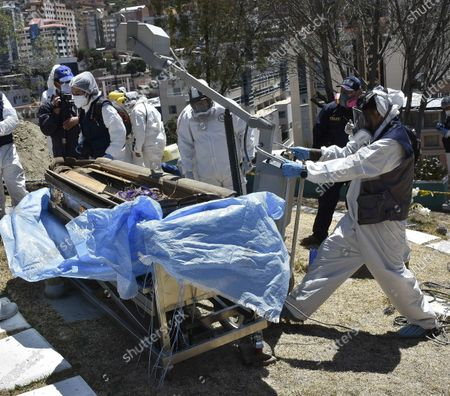 A forensic team works in a cemetery to carry out the exhumation of the remains that were attributed to a former police officer accused of femicide in La Paz, Bolivia, 25 September 2020. The Bolivian Prosecutor's Office exhumed the alleged body of Jorge Clavijo on 25 September following inconsistencies discovered in the expert reports that determined the way Clavijo had died. In February 2013, Clavijo allegedly murdered his wife, journalist Hanalí Huaycho. The then police lieutenant escaped without a trace until almost a month later a decomposing corpse was identified as his. Clavijo, was a member of a dissolved elite police group that operated against an apparent terrorist group, and which is believed to have received protection from the Government of Evo Morales.
