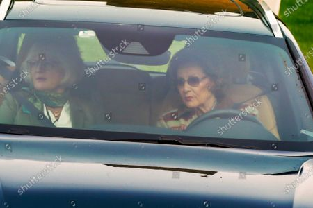 Norway's Queen Sonja (R) is driving out of the Rikshospitalet (Oslo University Hospital) after Norwegian King Harald was admitted to hospital and is on sick leave.