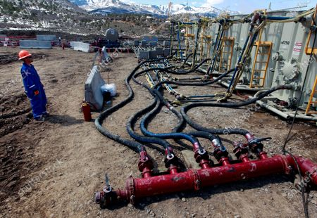 Stock Picture of A worker helps monitor water pumping pressure and temperature, at an oil and natural gas extraction site, outside Rifle, on the Western Slope of Colorado. A federal judge has ruled that the Trump administration's leading steward of public lands has been serving unlawfully and blocked him from continuing in the position. U.S. District Judge Brian Morris said, that U.S. Bureau of Land Management acting director William Perry Pendley was never confirmed to the post by the U.S. Senate and served unlawfully for 424 days