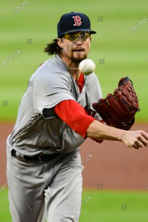 Boston Red Sox pitcher Chris Mazza works against the Atlanta Braves during the first inning of a baseball game, in Atlanta