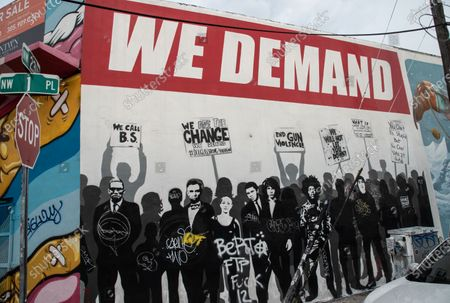 A powerful mural of people, who have impacted peoples lives in and out of the U.S. is seen on a street in Wynwood, the art district of Miami. CDC Shutters Dining and Bars, saying it's risky due to the spread of COVID-19.